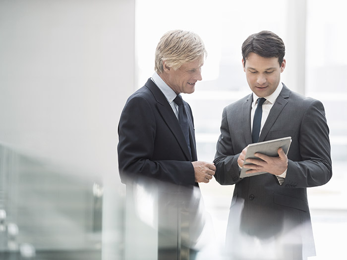 Businessmen with tablet | Atradius