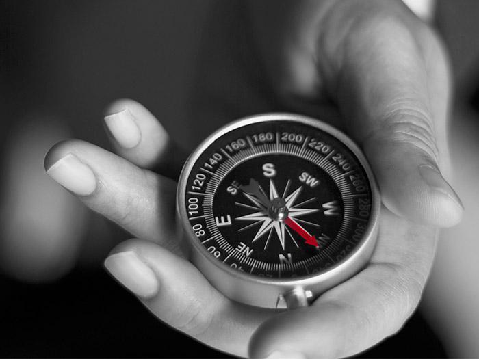 Holding a compass | Atradius